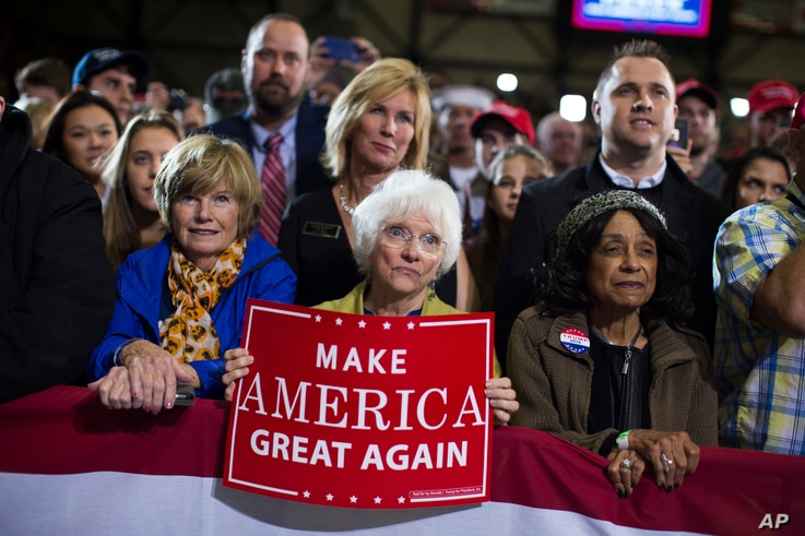 Supporters of Republican presidential candidate Donald Trump watch him speak during a campaign rally in Grand Rapids, Michigan, Oct. 31, 2016.