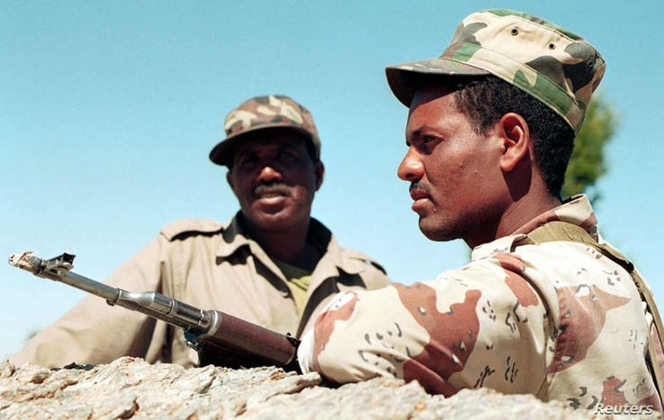 Tsorona, EritreaTwo Eritrean soldiers keep a watchful eye on the disputed Eritrean/Ethiopian border from a vantage point ot top of Eigar Mountain January 25.