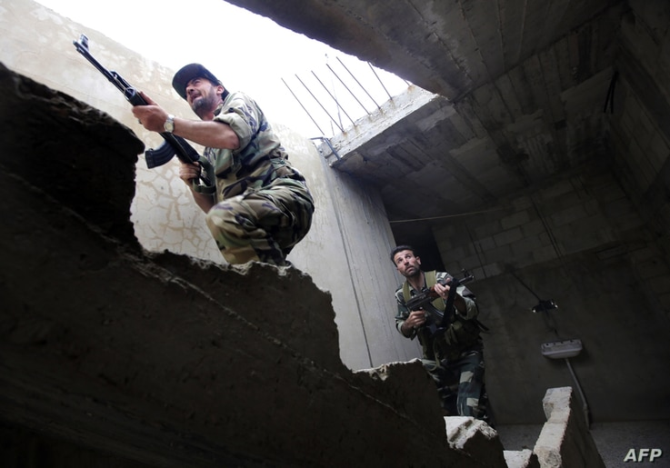 Syrian troops take control of the village of Western Dumayna, near the rebel-held city of Qusayr, on May 13, 2013.