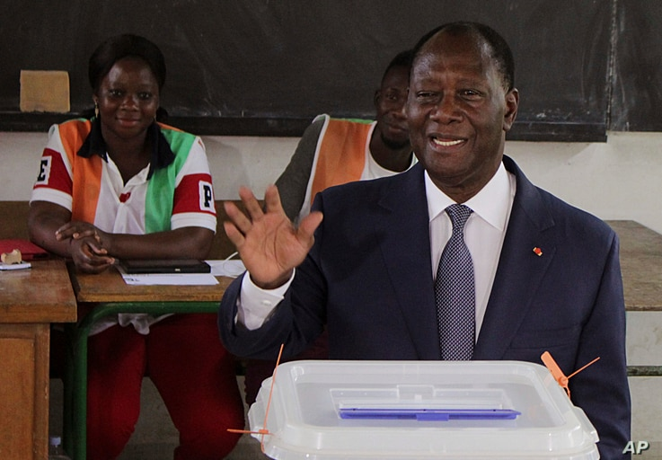 FILE - Ivory Coast's President Alassane Ouattara gestures after casting his ballot during Ivory Cost referendum in Abidjan, Ivory Coast, Oct. 30, 2016.