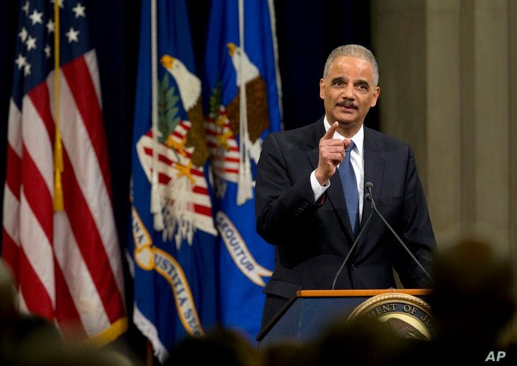 Attorney General Eric Holder speaks at a farewell gathering at the Justice Department in Washington, April 24, 2015.  Holder was bidding farewell to the Justice Department after six years as the nation's top law enforcement official.