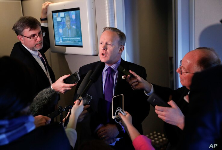 """White House press secretary Sean Spicer speaks to reporters on Air Force One en route to Andrews Air Force Base from Philadelphia, Jan. 26, 2017. Spicer says that taxing imports from Mexico would generate $10 billion a year and """"easily pay for the wa..."""