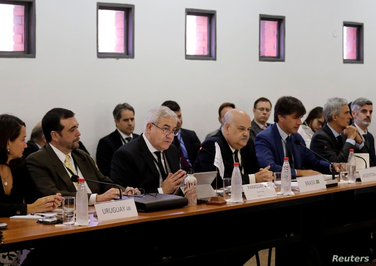 FILE - Negotiators of the Latin American bloc Mercosur and the European Union (not pictured) meet to continue discussions on a free trade deal, in Luque, Paraguay, Feb. 21, 2018.