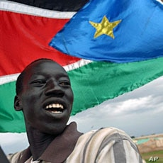 A resident of Abyei marches with the Southern Sudan flag (File)