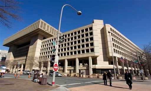 FILE - This Feb. 3, 2012 file photo shows Federal Bureau of Investigation (FBI) headquarters in Washington. Just six blocks from the White House, the FBI's hulking headquarters overlooking Pennsylvania Avenue has long been the government building eve
