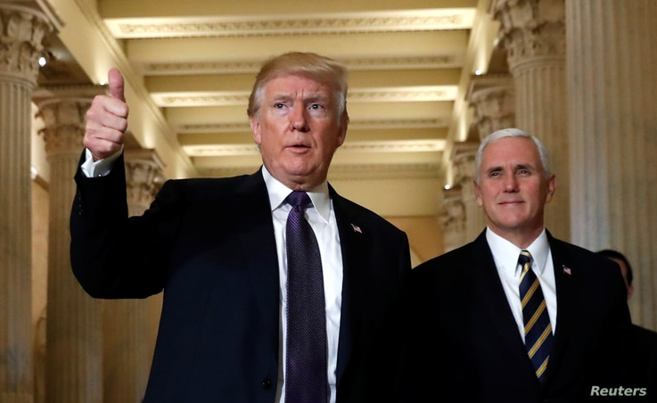 U.S. President Donald Trump gives a thumbs-up as he and Vice President Mike Pence depart the U.S. Capitol after a meeting to discuss tax legislation with House Republicans,  Nov. 16, 2017.