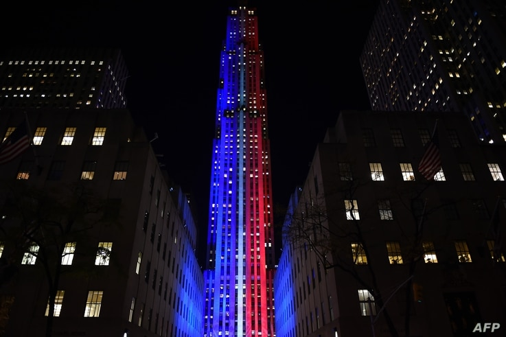 Rockefeller Center and Rockefeller Plaza is lit up in red and blue to mark the electoral progress of Hillary Clinton and Donald Trump and a map of the United States superimposed on the skating rink, Nov. 7, 2016 as part of NBC's election night covera...