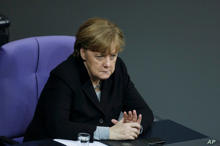 German Chancellor Angela Merkel attends the debate at the German parliament Bundestag on the crime in Cologne during New Year's Eve, in Berlin, Germany, Jan. 13, 2016.