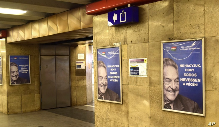 Advertisement in a metro station in Budapest photographed July 12, 2017. The Hungarian government says it will end its disputed ad campaign against Hungarian-American billionaire George Soros. The billboards, posters and TV ads were criticized by Hun...