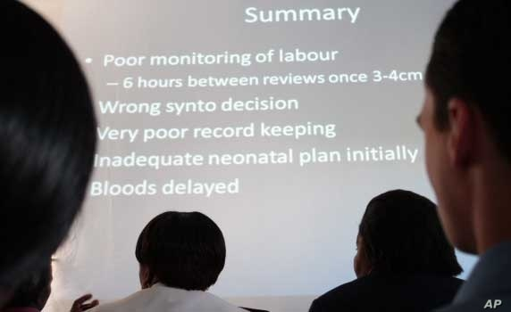 Clinical staff at a hospital in South Africa analyze problems at their facility during a meeting