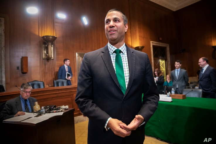 FCC Chairman Ajit Pai prepares to testify about his budget before a Senate Appropriations subcommittee on Capitol Hill in Washington, May 17, 2018.