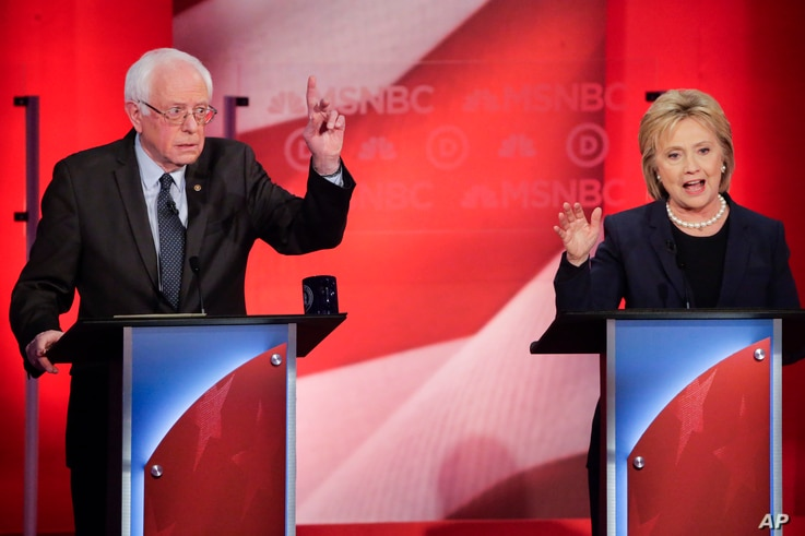 Sen. Bernie Sanders of Vermont reacts to former Secretary of State Hillary Clinton's answer to a question during a Democratic presidential primary debate hosted by MSNBC at the University of New Hampshire in Durham, Feb. 4, 2016.