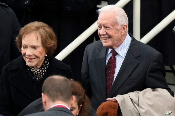Former President Jimmy Carter and former first lady Rosalynn Carter arrive during the 58th Presidential Inauguration at the U.S. Capitol in Washington, Jan. 20, 2017.