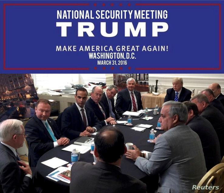 George Papadopoulos (3rd L) appears in a photograph released on Donald Trump's social media accounts with a headline stating that the scene was of his campaign's national security meeting in Washington, D.C., on March 31, 2016 and published April 1, ...