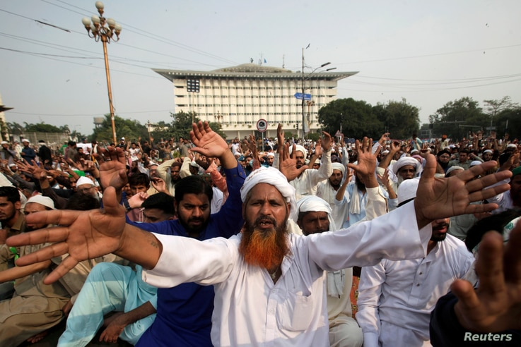 FILE - A supporter of the Tehreek e-Labbaik Pakistan (TLP) Islamist political party chants slogans with others during a protest after the Supreme Court overturned the conviction of a Christian woman sentenced to death for blasphemy against Islam, in ...