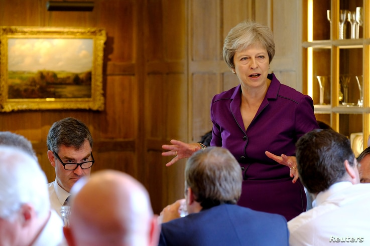 Britain's Prime Minister Theresa May commences a meeting with her cabinet to discuss the government's Brexit plans at Chequers, the Prime Minister's official country residence, near Aylesbury, Britain, July 6, 2018.