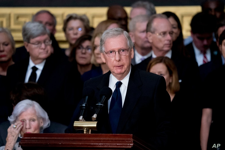Senate Majority Leader Mitch McConnell of Kentucky speaks during a ceremony for Sen. John McCain, R-Ariz., as he lies in state in the Rotunda of the U.S. Capitol, Aug. 31, 2018, in Washington.