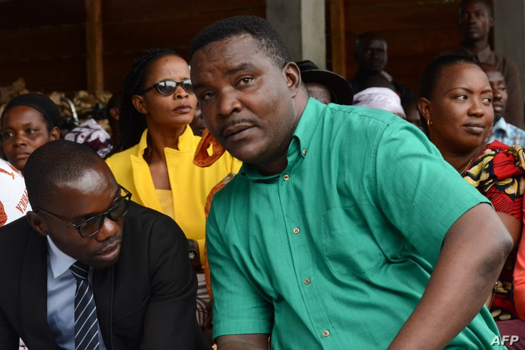 Melchiade Nzopfabarushe (R), member of Burundi's ruling National Council for the Defense of Democracy–Forces for the Defense of Democracy (CNDD-FDD) party and accused of inciting members of the ruling party to assassinate political opponents, is pi...