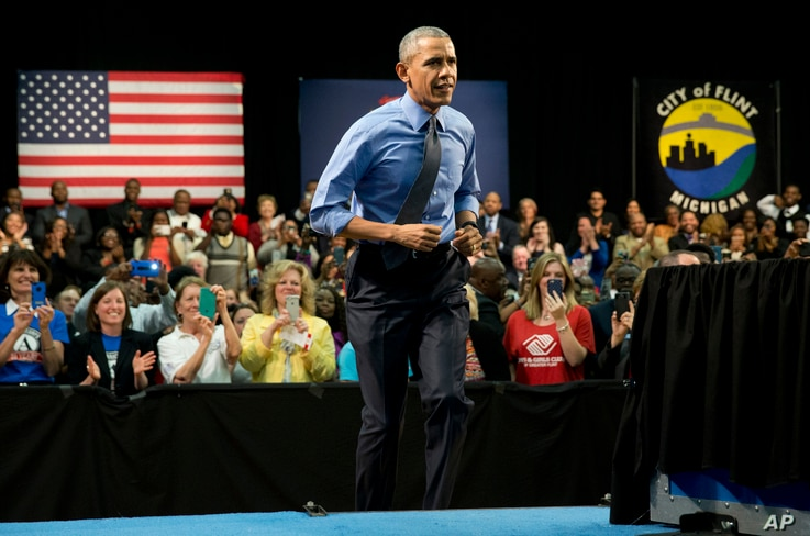 President Barack Obama arrives to speak at Flint Northwestern High School in Flint, Michigan, May 4, 2016, about the ongoing water crisis. In his address, he acknowledged the crisis was man-made and a result of poor decisions.