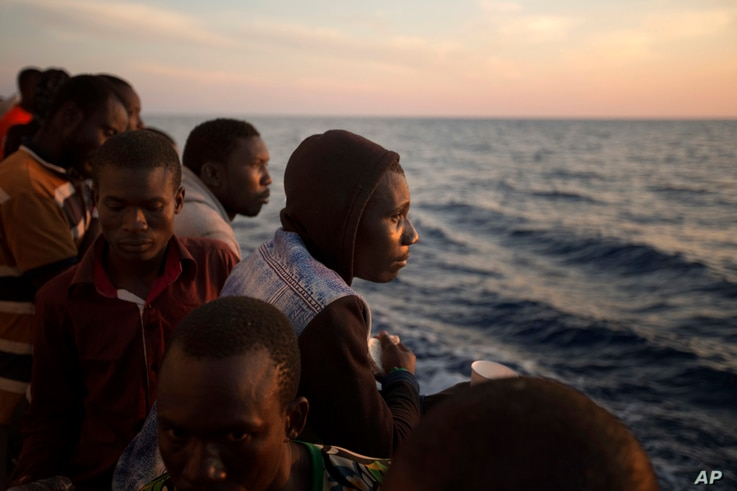 Sub-Saharan migrants stand on the deck of the Golfo Azzurro rescue vessel as they arrive at the port of Pozzallo, Italy, June 17, 2017.