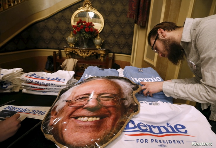 A vendor looks for a t-shirt size at a U.S. Democratic presidential candidate Bernie Sanders' campaign event in Sioux City, Iowa, United States, Jan. 19, 2016.