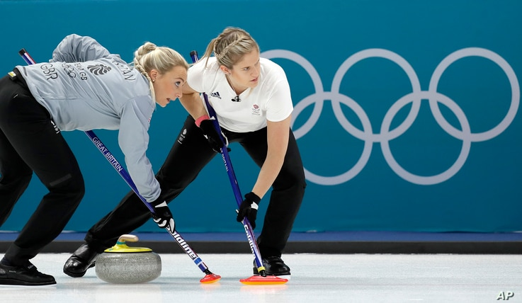 Britain's Anna Sloan, left, sweeps ice with her teammate during their women's curling match against Denmark at the 2018 Winter Olympics in Gangneung, South Korea, Feb. 17, 2018.