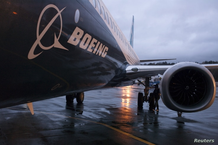 FILE - A Boeing 737 MAX sits outside the hangar during a media tour of the Boeing 737 MAX at the Boeing plant in Renton, Washington.