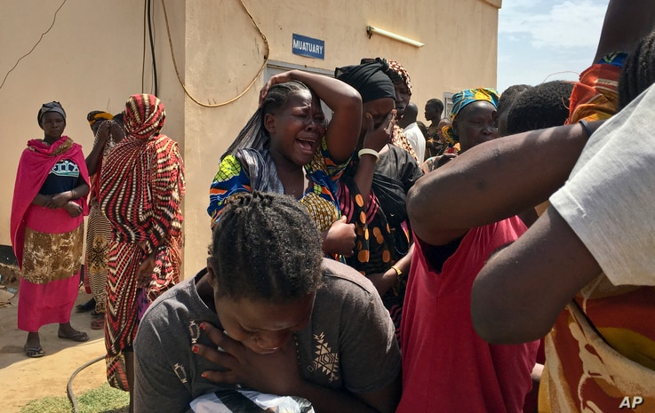 Relatives of the six aid workers who were killed grieve in Juba, South Sudan, March 27, 2017.  Twelve aid workers have been killed so far this year in South Sudan.