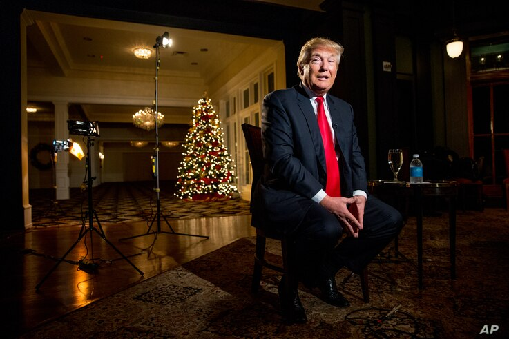 FILE - Republican presidential candidate Donald Trump speaks during an interview at the Trump National Golf Club in Sterling, Virginia, Dec. 2, 2015.