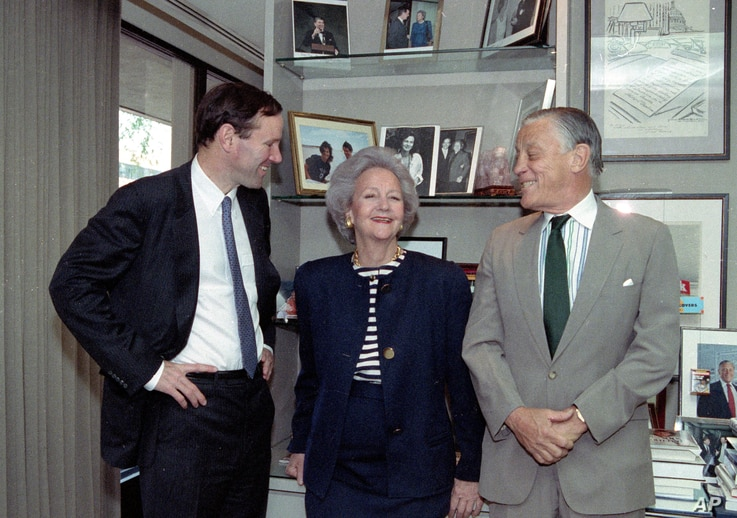 A May 8, 1991 photo shows Katharine Graham, Chairman of the Washington Post poseingwith her son publisher Donald Graham (L) and Ben Bradlee, executive editor of the post, in her office in New York City.