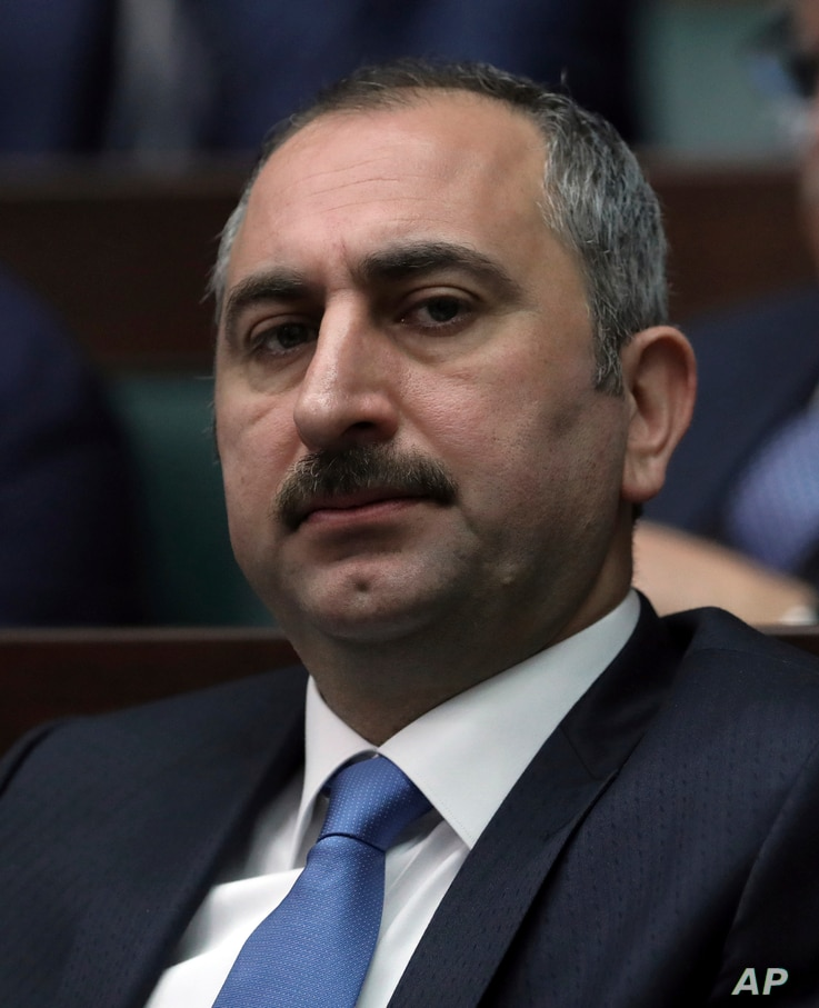 FILE - In this Feb. 6, 2016 file photo, Turkish Justice Minister Abdulhamit Gul attends a parliament session in Ankara, Turkey.