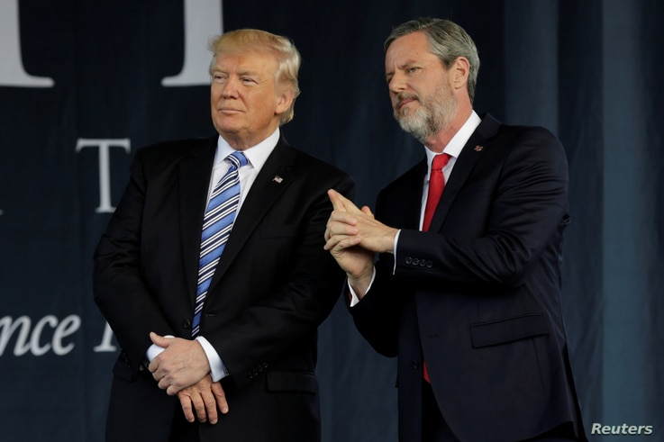 U.S. President Donald Trump, left, stands with Liberty University President Jerry Falwell, Jr. after delivering keynote address at commencement in Lynchburg, Virginia, May 13, 2017.