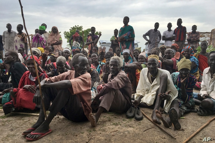 Displaced South Sudanese gather during a visit by the United Nations to a new site for displaced people in Bentiu, South Sudan, June 18, 2017.