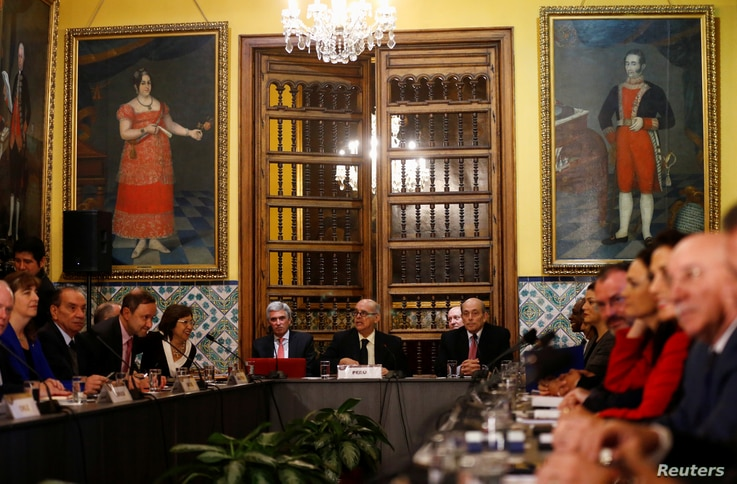 Peru's Foreign affair minister Ricardo Luna, center, and foreign affairs ministers and representatives from across the Americas meet to discuss issues related to the Venezuelan crisis, in Lima, Peru, Aug. 8, 2017.