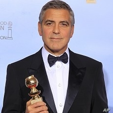 "George Clooney poses with his award for best actor in a motion picture - drama for ""The Descendants,"" backstage at the 69th annual Golden Globe Awards in Beverly Hills, California, January 15, 2012."