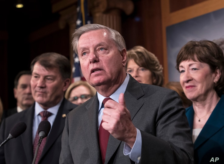 Sen. Lindsey Graham, R-S.C., flanked by Sen. Mike Rounds, R-S.D., left, and Sen. Susan Collins, R-Maine, discusses efforts to reach agreement on immigration reform, during a news conference at the Capitol in Washington, Feb. 15, 2018.