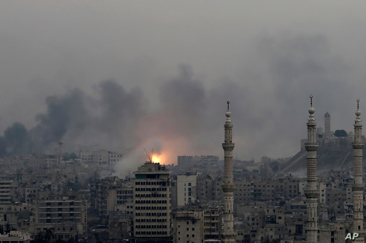 A ball of fire rises following a Syrian government air strike that hit rebel positions in the eastern neighborhoods of Aleppo, Syria, Dec. 5, 2016.