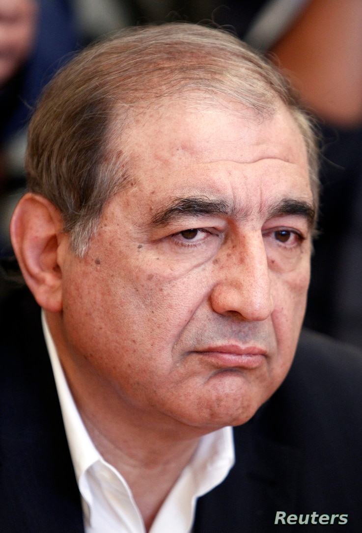 Syrian Deputy Prime Minister for Economic Affairs Qadri Jamil listens during a meeting with Russian Foreign Minister Sergei Lavrov in Moscow, July 22, 2013.