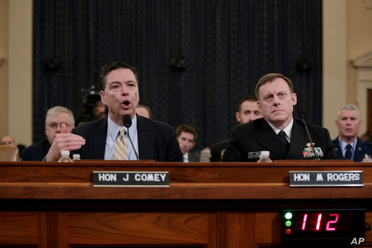 FBI Director James Comey, left, joined by National Security Agency Director Michael Rogers, right, testifies on Capitol Hill in Washington before the House Intelligence Committee hearing on allegations of Russian interference in the 2016 U.S. preside...