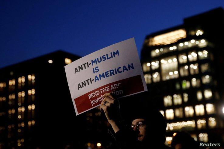 Demonstrators gather at Washington Square Park to protest against U.S. President Donald Trump in New York, Jan. 25, 2017.