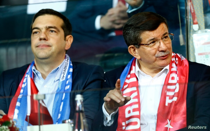 Greek Prime Minister Alexis Tsipras (L) and Turkish Prime Minister Ahmet Davutoglu watch the soccer match Nov. 17, 2015, between Turkey and Greece in Istanbul.