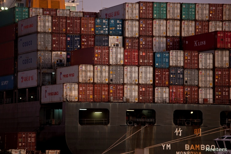 FILE - The YM Bamboo, a container ship operated by the China Ocean Shipping Company, is docked at the Port of Oakland in Oakland, California on January 14, 2011.
