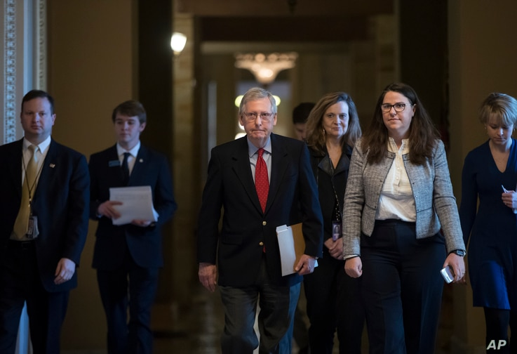Senate Majority Leader Mitch McConnell, R-Ky., walks to the chamber on the first morning of a government shutdown after a divided Senate rejected a funding measure last night, at the Capitol in Washington, Jan. 20, 2018.