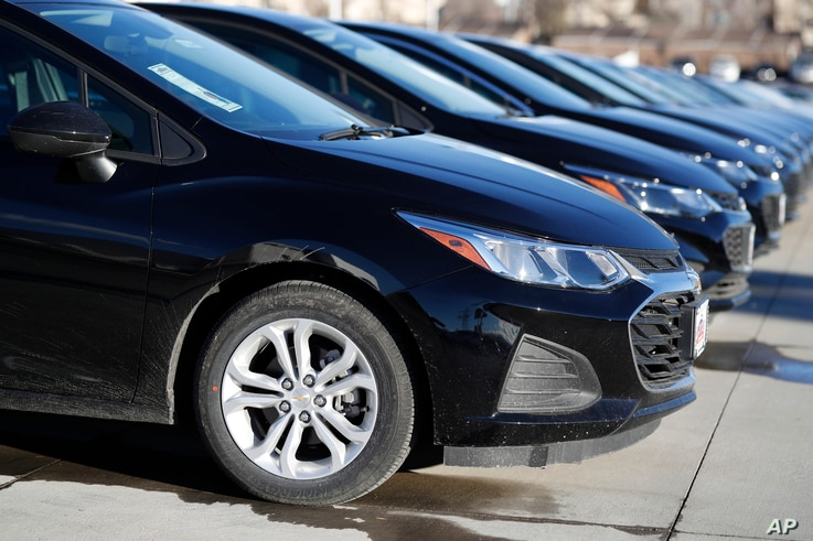 A long row of unsold 2019 Cruze sedans sits at a Chevrolet dealership in Littleton, Colo., Feb. 3, 2019.