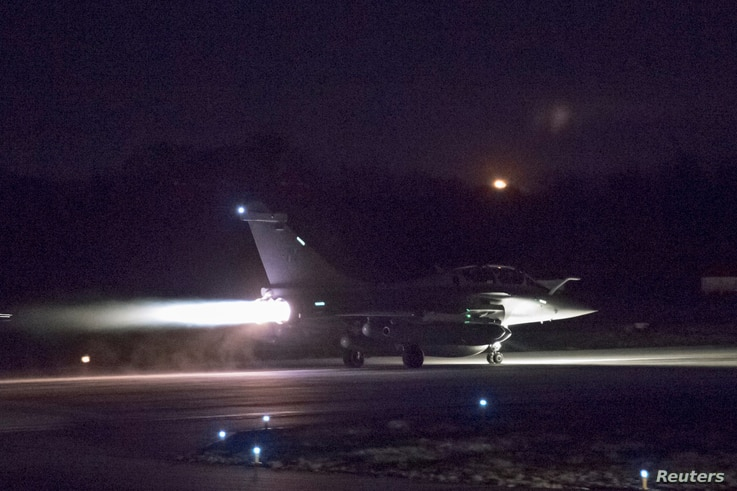 A plane preparing to take off as part of the joint airstrike operation by the British, French and U.S. militaries in Syria, is seen in this picture obtained April 14, 2018, via social media.