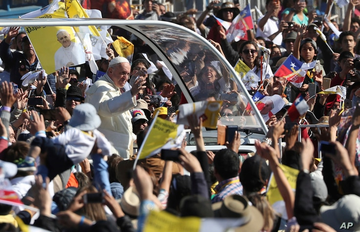 Pope Francis arrives on the pope-mobile to the Maquehue Air Base, to celebrate a Mass in Temuco, Chile, Jan. 17, 2018.