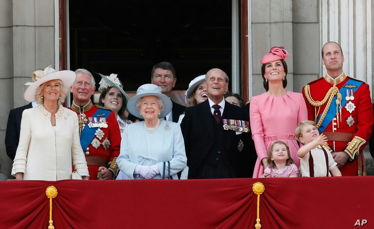 Members of Britain's Royal family from left, Camilla, the Duchess of Cornwall, Prince Charles, Princess Eugenie, Queen Elizabeth II, background Timothy Laurence, Princess Beatrice, Prince Philip, Kate, the Duchess of Cambridge, Princess Charlotte, Pr