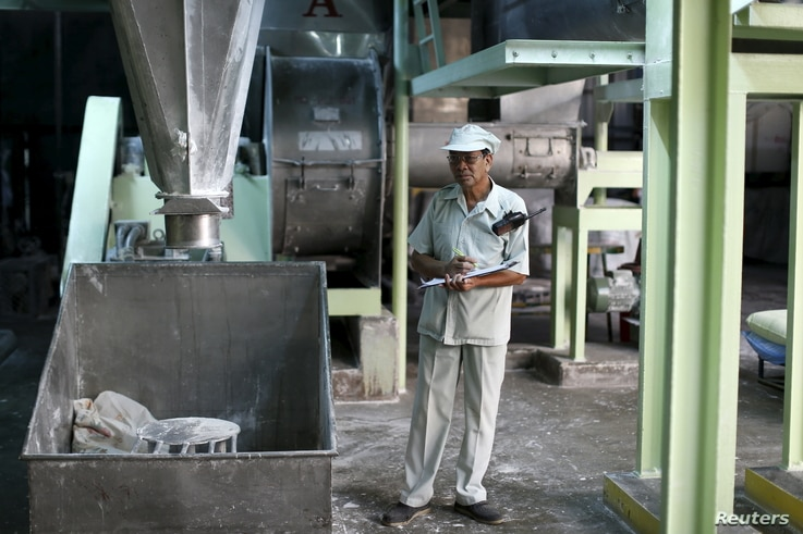 Thongdee Saenghow, a 62-year-old production supervisor, works at a rice vermicelli factory outside Bangkok, Thailand, Feb. 5, 2016.