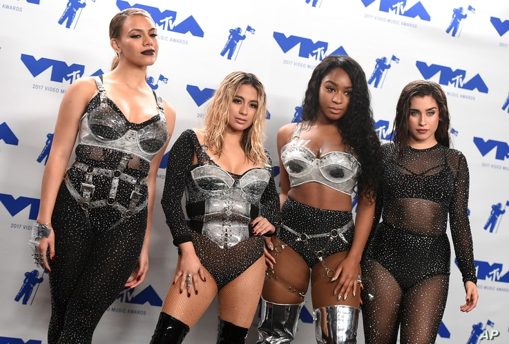"Dinah Jane, from left, Ally Brooke, Normani Kordei, and Lauren Jauregui of Fifth Harmony, winners of the award for best pop video for ""Down,"" pose in the press room at the MTV Video Music Awards."