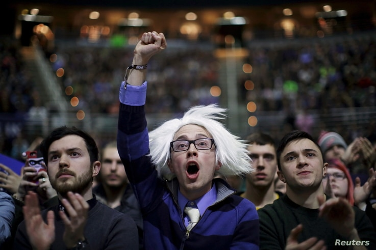 Supporters cheer at a campaign rally for U.S. Democratic presidential candidate Bernie Sanders in East Lansing, Michigan, March 2, 2016.